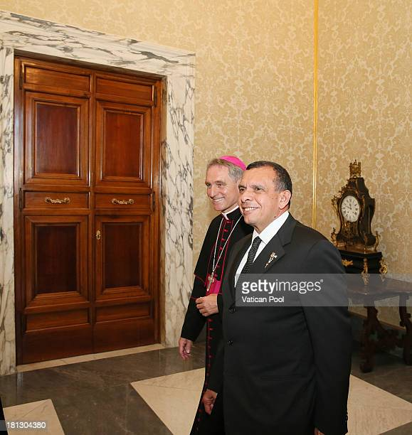 Honduras President Porfirio Lobo Sosa flanked by Prefect of the Pontifical House and former personal secretary of Pope Benedict XVI Georg Ganswein...