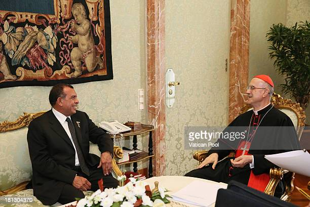 Honduras President Porfirio Lobo Sosa meets Vatican Secretary of State cardinal Tarcisio Bertone after an audience with Pope Francis on September 20...