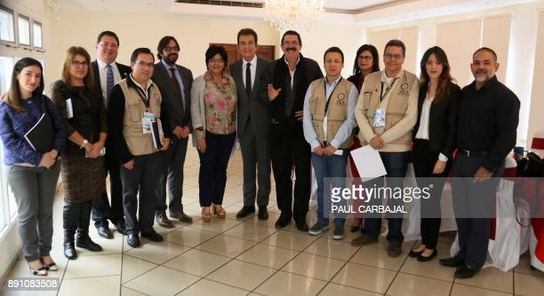 Honduras' presidential candidate for the Opposition Alliance against Dictatorship party Salvador Nasralla poses with members of the Organization of...
