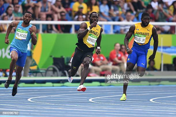 Honduras' Rolando Palacios Jamaica's Nickel Ashmeade and Barbados' Burkheart Ellis Jr compete in the Men's 200m Round 1 during the athletics event at...