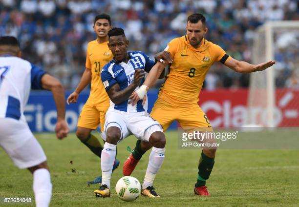 Honduras' Romell Quioto and Australia's Bailey Wright vie for the ball during the first leg football match of their 2018 World Cup qualifying playoff...