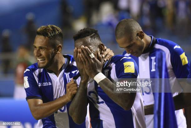 Honduras' Romell Quioto celebrates with teammates after scoring against Mexico during their 2018 World Cup qualifier football match which Honduras...