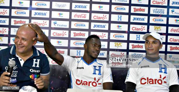 Honduras team captain Mynor Figueroa flanked by goalie Donys Escober jokes with Honduras' Football Federation representative Edwin Martin Banegas...