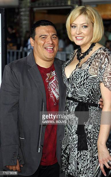 Hondurasborn US actor/comedian Carlos Mencia arrives with his wife Amy for the premiere of The Heartbreak Kid 27 September 2007 in Los Angeles The...