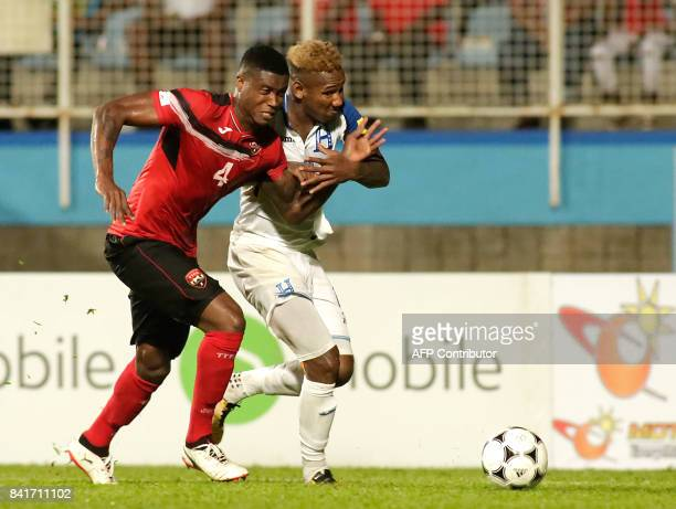 Honduras'midfielder Romell Quioto and Trinidad and Tobago's Sheldon Bateau vie for the ball during their FIFA World Cup 2018 CONCACAF qualifiers...