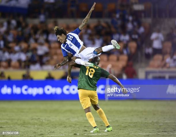 Honduras's defender Henry Figueroa and French Guiana's forward Sloan Privat vie for the ball during the second half of the Honduras vs French Guiana...