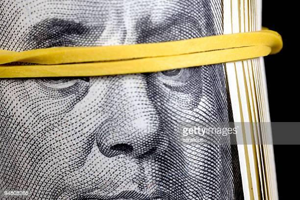 honest or rich? - bundle of dollars - justice concept stock pictures, royalty-free photos & images