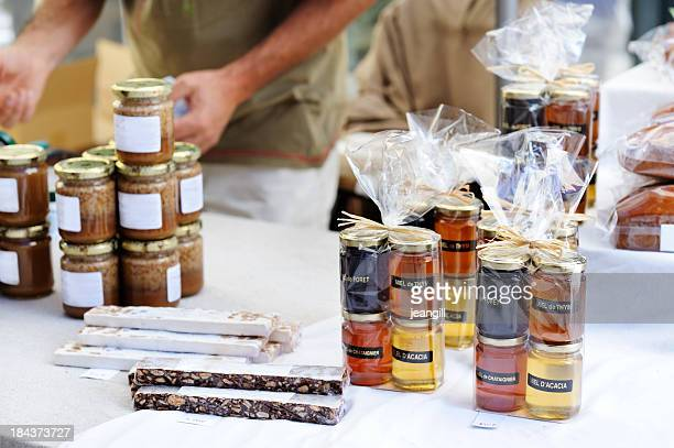 honey and nougat on french market stall - fete stock photos and pictures
