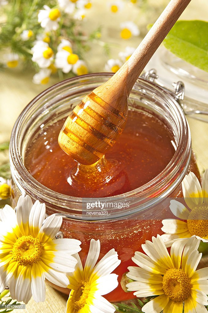 Honey and wildflowers : Stock Photo