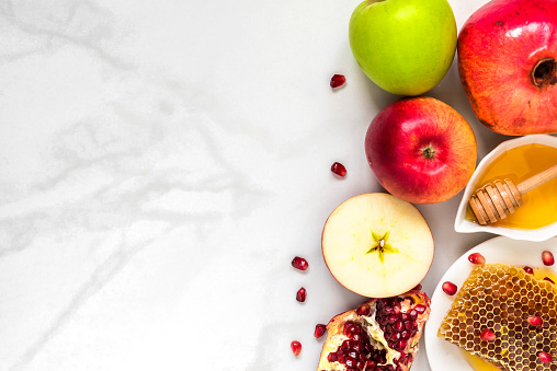 Honey, apple and pomegranate. traditional food for Jewish New Year Holiday, Rosh Hashanah on marble table. top view 1026051204