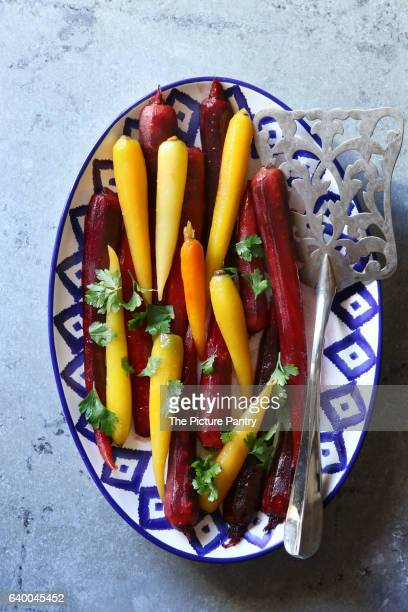 Honey glazed rainbow carrots on a plate.Top view