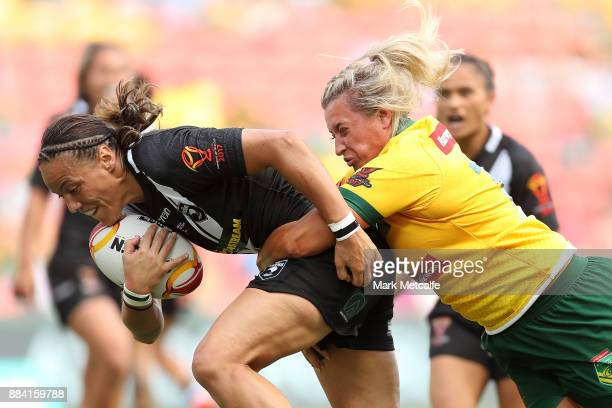 Honey Hireme of the Ferns is tackled by Ruan Sims of the Jillaroos during the 2017 Rugby League Women's World Cup Final between Australia and New...