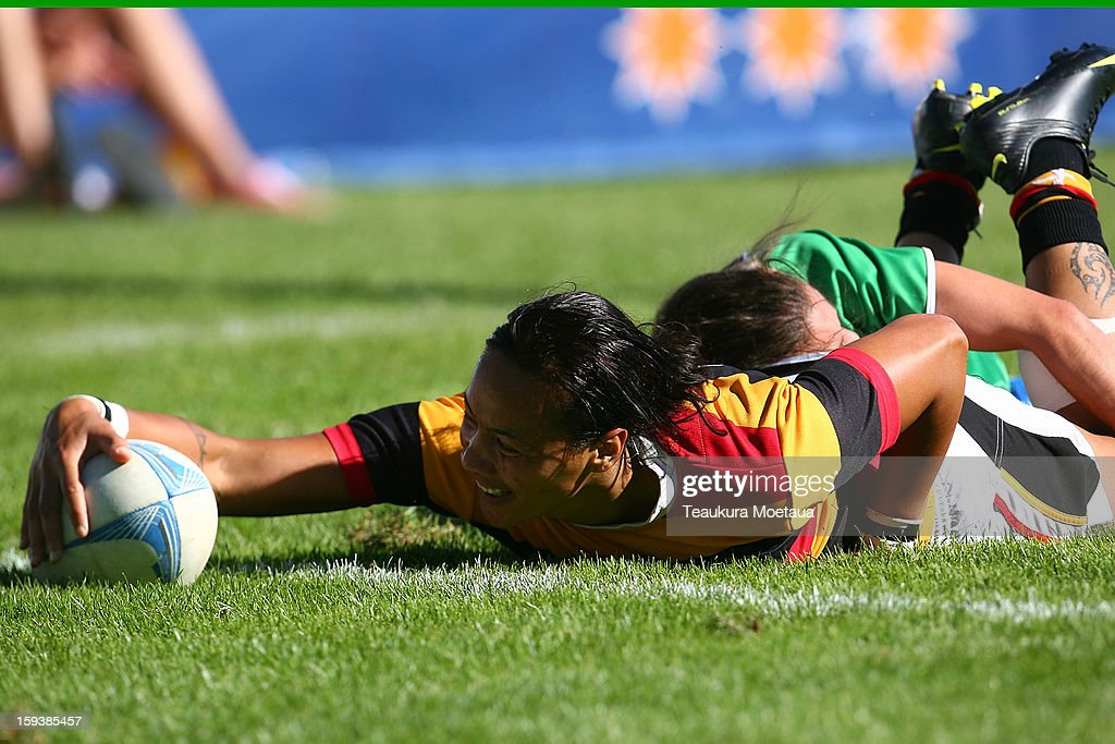 Honey Hireme of Waikato scores a try Manawatu during the National Rugby Sevens final at the Queenstown Recreation Ground on January 13, 2013 in Queenstown, New Zealand.