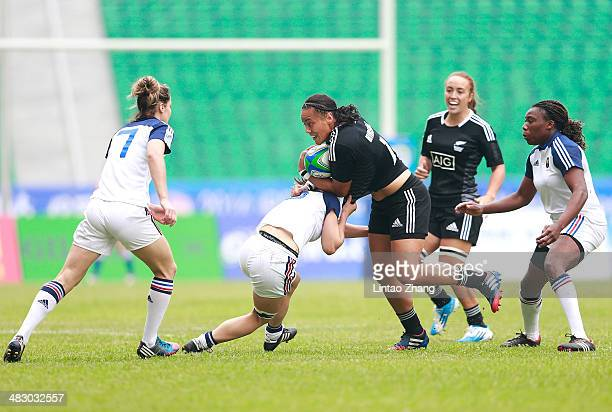 Honey Hreme of New Zealand is tackled by Camille Grassineau of France during the day two of IRB Women's Sevens World Series match between New Zealand...
