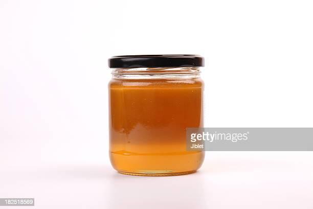 Honig Krug auf weißem Hintergrund