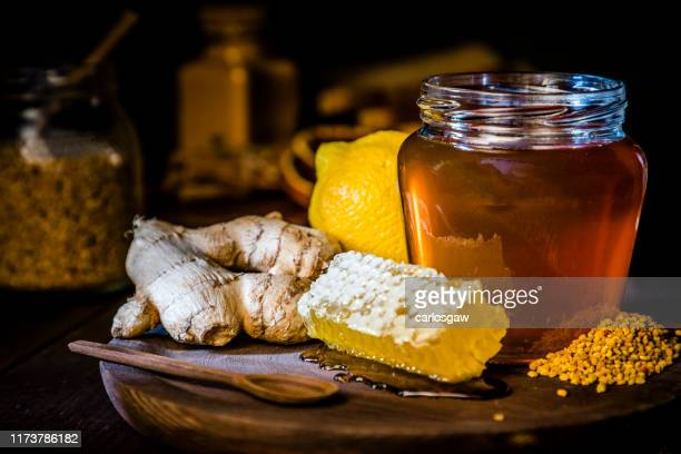honey jar with honeycomb and bee pollen, ginger and lime - ginger spice stock pictures, royalty-free photos & images