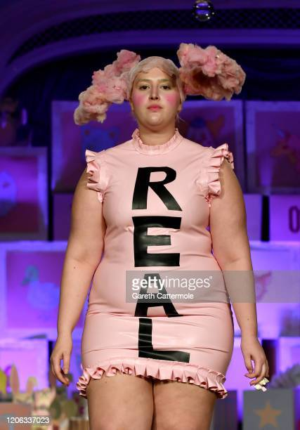 Honey Kinney Ross walks the runway at the VIN + OMI show during London Fashion Week February 2020 at The Savoy Hotel on February 14, 2020 in London,...