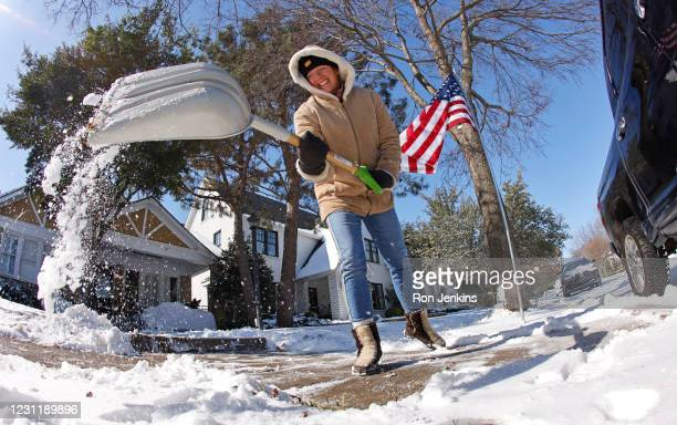 Honey Russell shovels snow from her sidewalk after a snow storm February 15, 2021 in Fort Worth, Texas. Winter storm Uri has brought historic cold...