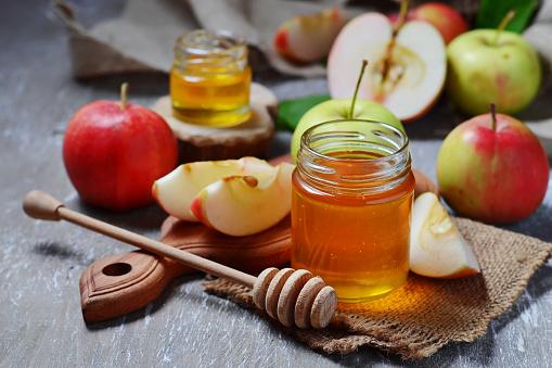 Honey with apple for Rosh Hashana, jewish New Year 498147638
