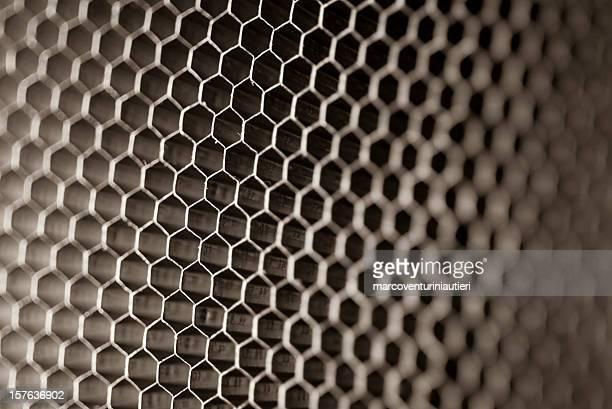 Alvéole plat de près, texture abstraite avec lumière