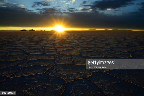 Honeycomb structure on the salt lake at sunset with clouds, Salar de Uyuni, Uyuni, Potosi, Bolivia