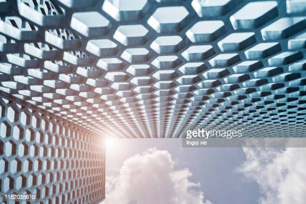 Honeycomb structure under blue sky and white clouds