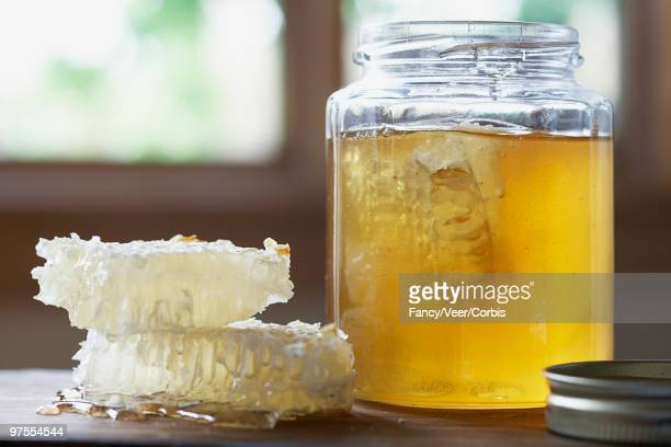 Honeycombs and a jar of honey