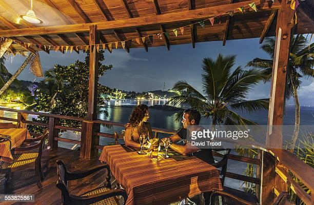 Honeymoon couple at restaurant at dusk.