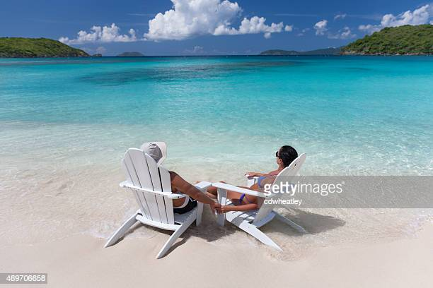 honeymoon couple holding hands and relaxing at a Caribbean beach