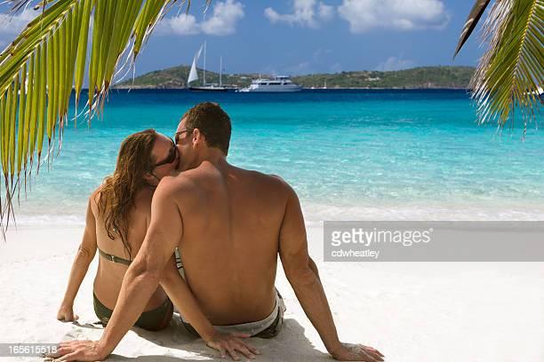 honeymoon couple kissing at a tropical beach in the Caribbean