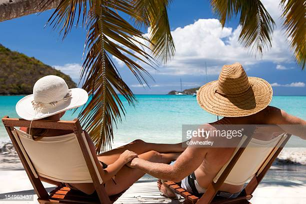 honeymoon couple relaxing at a Caribbean beach on summer vacation