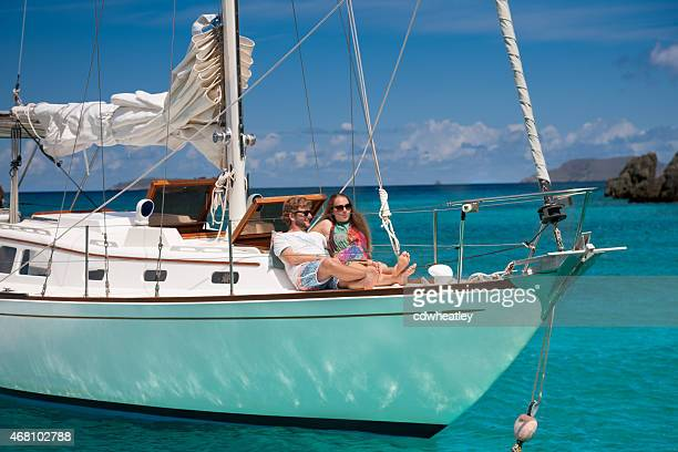 honeymoon couple relaxing on a luxury sailboat in the Caribbean