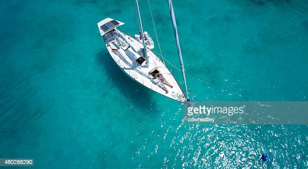 honeymoon couple relaxing on a sailboat in the Caribbean