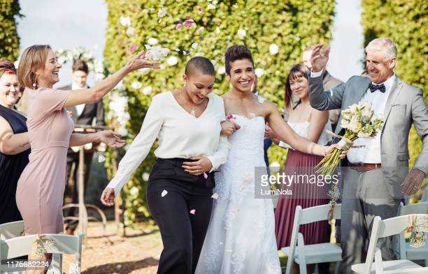 honeymoon here we come! - civil partnership stock pictures, royalty-free photos & images