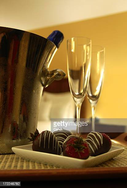 honeymoon with champagne and chocolate dipped strawberries - chocolate dipped stock pictures, royalty-free photos & images