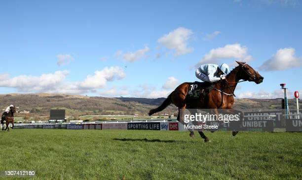 Honeysuckle ridden by Rachael Blackmore passes the winning post to win the Unibet Champion Hurdle Challenge Trophy on Day One of the Cheltenham...