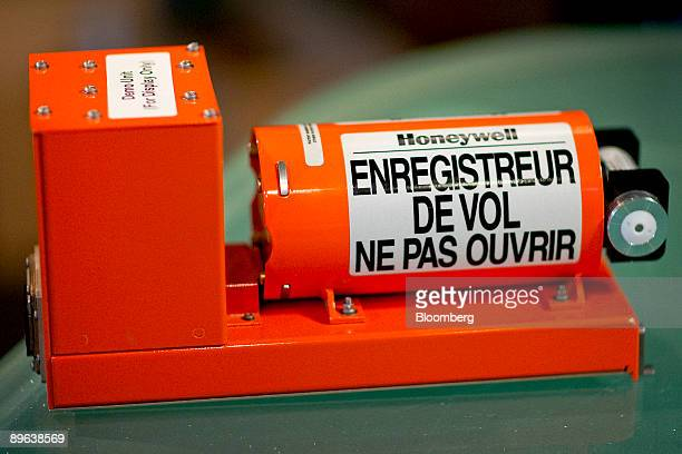 Honeywell International Inc commercial aircraft cockpit data recorder or 'black box' with instructions written in French is arranged for a photo in...