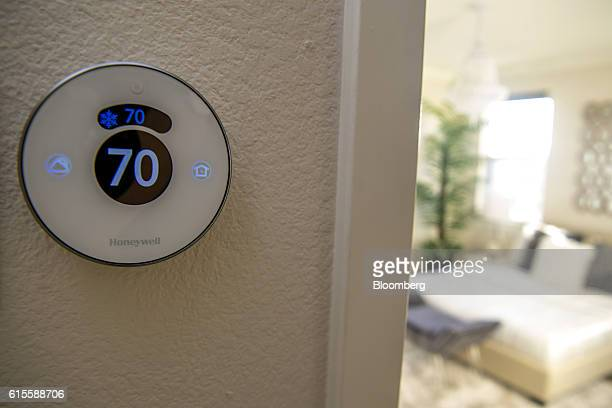 Honeywell International Inc Lyric Round WiFI smart thermostat hangs on display inside a home at the Lennar Corp Marina Shores development in Alameda...