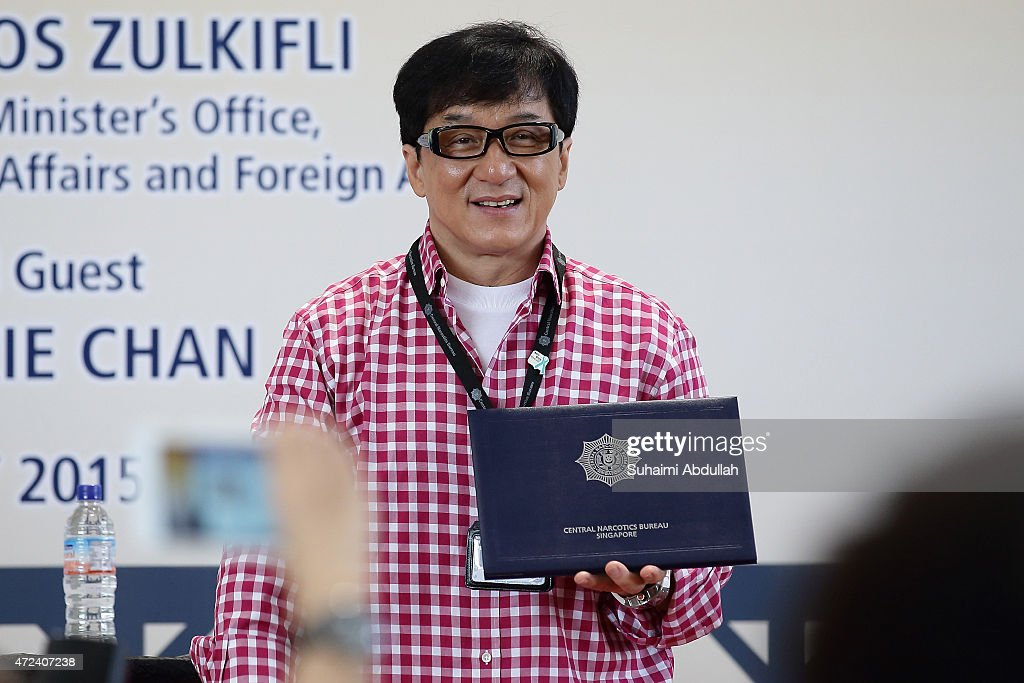 Hong actor and director, Jackie Chan is seen on stage during the launch of a new mobile anti-drug game application, Aversion at Nanyang Polytechnic on May 7, 2015 in Singapore. Jackie Chan was named Singapore's first celebrity anti-drug ambassador.