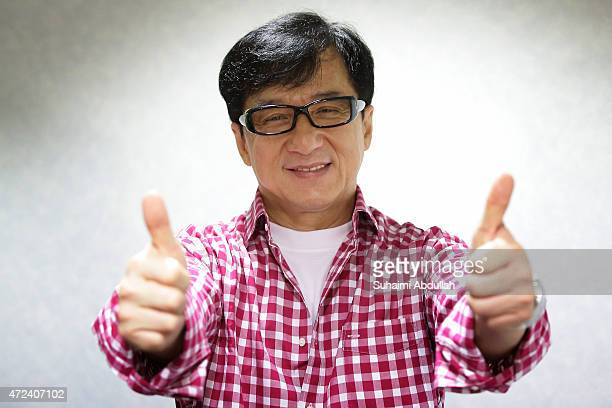 Hong actor and director Jackie Chan poses for a photo prior to the launch of a new mobile antidrug game application Aversion at Nanyang Polytechnic...