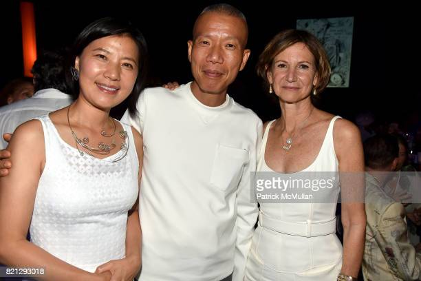 Hong Hong Wu Cai GuoQiang and Toni Ross attend Boom The Cosmic LongHouse Benefit at LongHouse Reserve on July 22 2017 in East Hampton New York