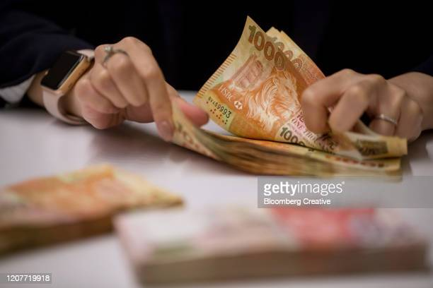 hong kong 1000 dollar banknotes - chinese currency stock pictures, royalty-free photos & images