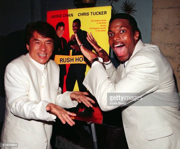 Hong Kong action movie actor Jacke Chan and US actor Chris Tucker have fun after arriving for the premiere of their new film Rush Hour 09 September...