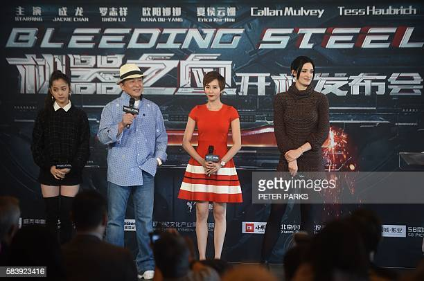 Hong Kong action movie star Jackie Chan speaks with his costars Nana OuYang Erica XiaHou and Tess Haubrich during a press coference at the Sydney...