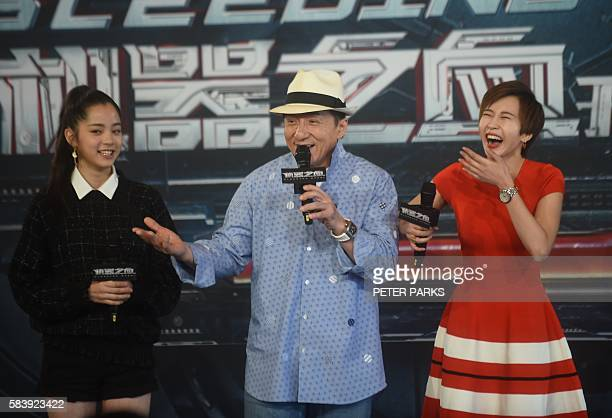 Hong Kong action movie star Jackie Chan speaks with his costars Nana OuYang and Erica XiaHou during a press coference at the Sydney Opera House in...