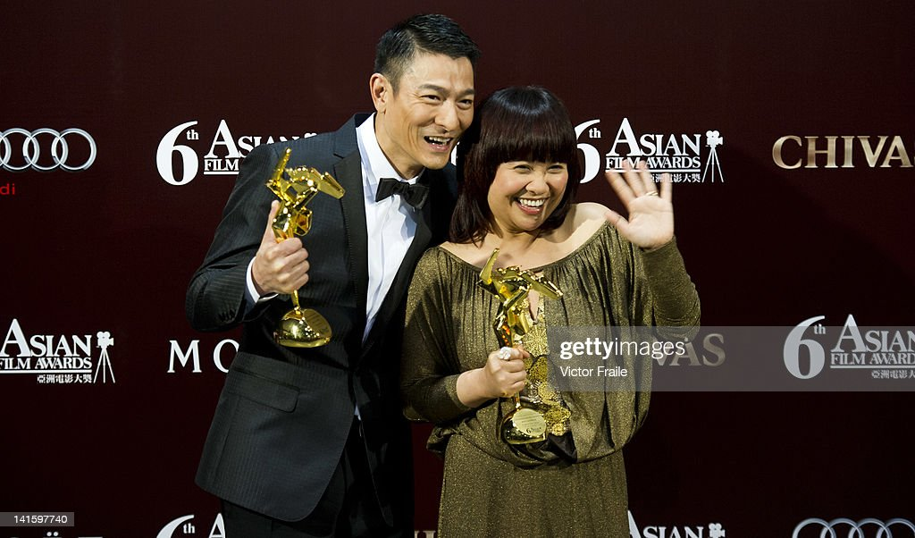 Hong Kong actor Andy Lau and Philippine actress Eugene Domingo pose with their trophies after winning the most popular actor and actress awards during the 6th Asian Film Awards, celebrating excellence in cinema, at Hong Kong Convention and Exhibition Center on 19 March 2012 in Hong Kong, China The event honours specifically filmmakers achievements in the field of Asian cinema, bringing together the best cinematic talent in Asia.