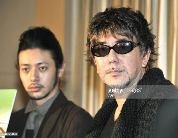 Hong Kong actor Anthony Wong poses with Japanese actor Joe Odagiri at a press conference for their latest movie Plastic City in Tokyo on February 3...