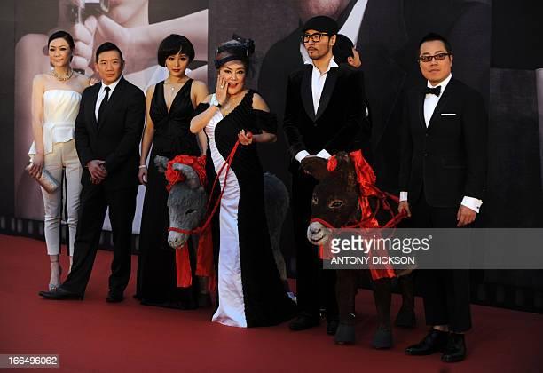 Hong Kong actor Chapman To and his wife Kristal director Pang Ho Cheung and Hong Kong actress Susan Shaw pose for photographers on the red carpet...