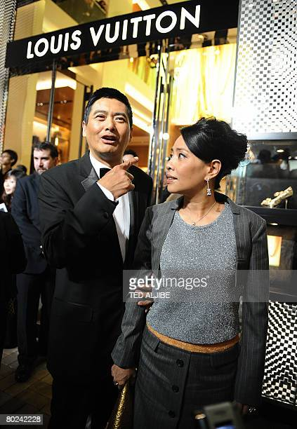 Hong Kong actor Chow Yun Fat and his wife Jasmine arrive for the reopening of a Louis Vuitton shop in Hong kong on March 14 2008 Louis Vuitton...