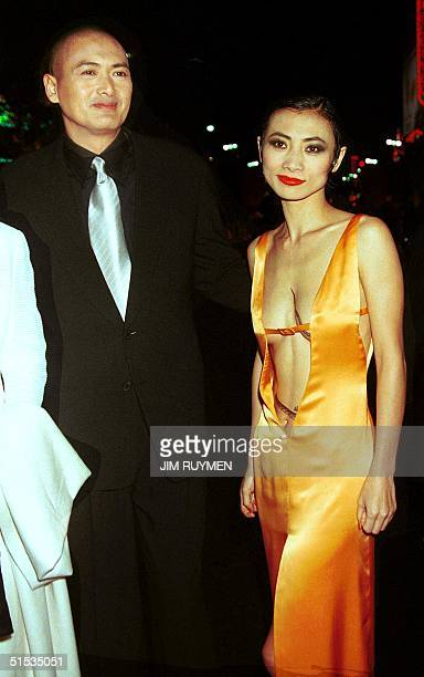Hong Kong actor Chow YunFat arrives with Chinese actress Bai Ling for the world premiere of their new film Anna and the King 15 December 1999 in...